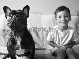 کودک و سگ